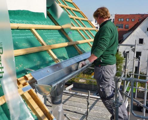 Unsere Mitarbeiter auch dem Dach